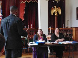Dana Hooven, SIC student from Harrisburg, acts as Senate Committee Chair in the Supreme Court Chambers of the Old State Capital during the state collegiate legislative competition.