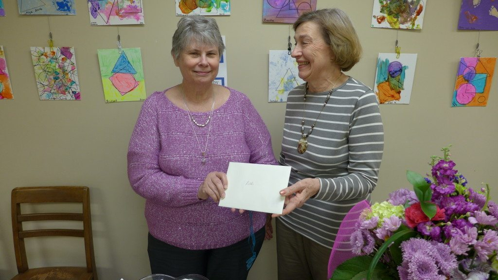 Lynda Clemmons gives an appreciation card to Ruth.
